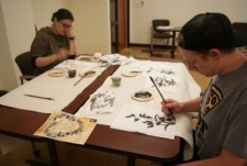 Students at a Chinese painting workshop.