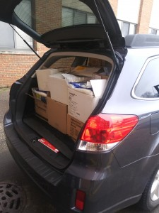 Boxes packed in the trunk of a vehicle.