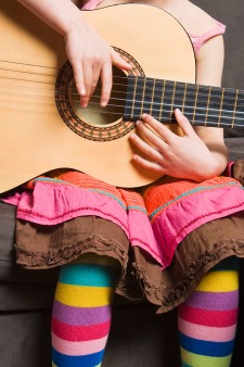 Photo of young girl with guitar.