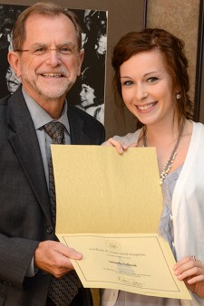 Photo of President John M. Dunn and Samantha Kulhanek.