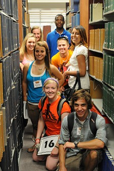 Photo of student orientation group in library.