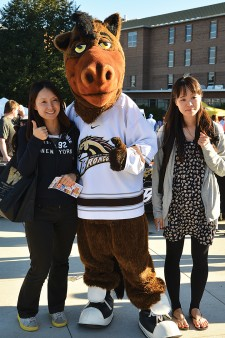 Photo of Bronco Bash attendees with Buster.
