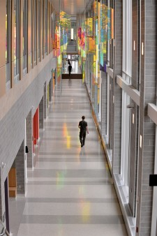 Photo of person walking down hallway in WMU's Sangren Hall.