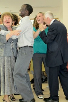 Photo of WMU students dancing with senior citizens.