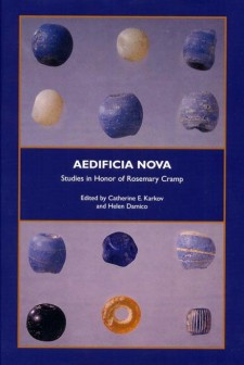 Cover image of Aedificia Nova: blue, gold, and cream glass beads on a lavendar background, with the title in a rectangular box in the middle of the cover.