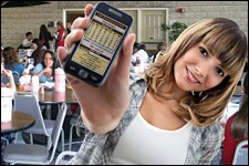 Photo of student with smartphone.