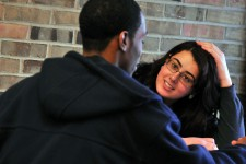Photo of two students talking.