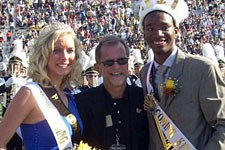 Photo of Homecoming Queen Katie Ballman and King Clifford Pulley III with President John Dunn.
