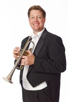 Photo of Alex Jokipii holding a trumpet.
