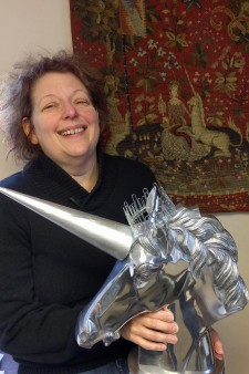 Image of Medieval Institute Director, Jana K. Schulman, holding the college trophy.