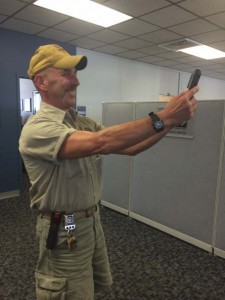 Maintenance services employee poses for a selfie