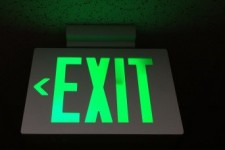 "green glowing ""EXIT"" sign"