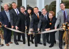 People cutting a ribbon in front of the Zhang Legacy Center