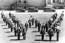 "Photo of the 1924 band assembled outside in a ""W"" formation."