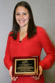Justine Morneau holds the plaque she received for winning MIRSA's outstanding student award.