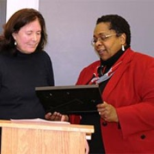 Helen Beck receives her award from Earlie Washington.