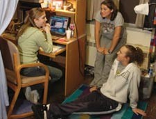 Three female students in a the Ackley residence hall.