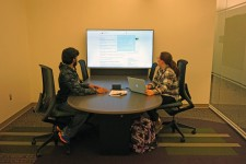 two students using one of the technology collaboration stations in the BCC