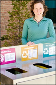 Photo of grad student Kate Binder next to new recycling bin.