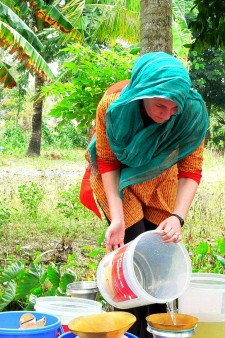 Woman filtering water.