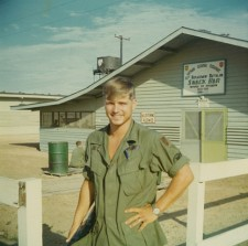 Photo of a young James McCloughan in fatigues in front of the Vietnam Regional Exchange Snack Shop.