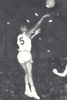 A young Manny Newsome shoots a basketball.