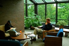 students in lounge area studying