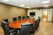 a wmu-grand rapids, beltline room with a conference table, ten office chairs, and lifesize video conferencing hardware.