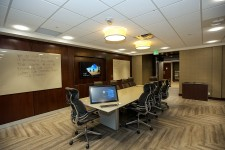 wmu-grand rapids, beltline large executive meeting room with large table, ten leather office chairs, whiteboards, large monitor, and large surface tablet.