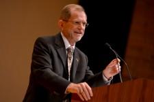 Photo of WMU President John M. Dunn speaking at a podium.