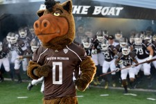 Photo of Buster Bronco with the WMU Football team.