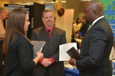 Photo of three people talking at a recent career fair.