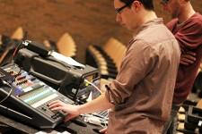 Photo of a student running a sound board.