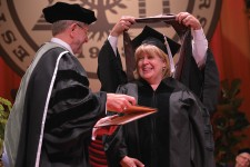 Photo of a WMU student receiving her degree.