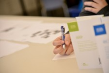 Photo of a student writing.