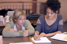 Photo of student receiving writing help.
