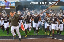 Photo of WMU football team with Head Coach P.J. Fleck.