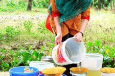 Photo of a woman filtering water.