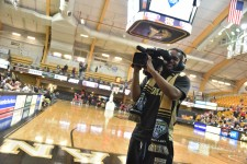 Photo of Sports Media student shooting video.