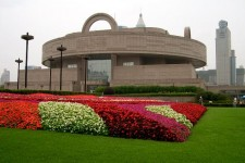 Photo of the Shanghai Museum of Ancient Art building surrounded by colorful flowers.