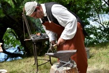 Photo of a man demonstrating a skill at the Fort St. Joseph archaeological site.