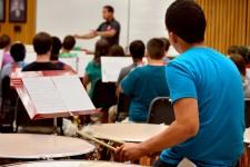 Photo of a Seminar Music Camp participant playing timpani.