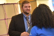 Photo of a student and employer at a WMU career fair.