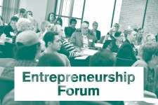 "Photo of a group of people seated at tables in a room, with a text overlay that says ""Entrepreneurship Forum."""