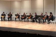 Photo of the Oakland University Guitar Emsemble performing on a stage