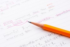 Photo of a pencil and piece of notebook paper with an English language exercise written on it.