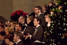 Photo of WMU singers on risers performing next to a Chirstmas tree.