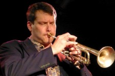 WMU's Dr. Scott Cowan plays trumet on stage.