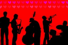 A silhouette of musicians playing various instruments under a pattern of small hearts.