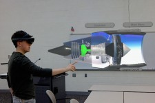 Student using virtual reality goggles to interact with a 3D jet engine.